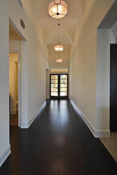 The foyer light was repeated down this long center hallway.  Home built by Canyon Custom Homes