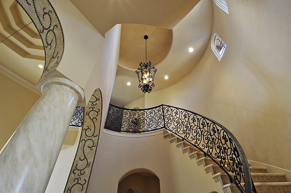 A large foyer light is needed for an expansive, two story entry space.  Home built by Stalwart Custom Homes