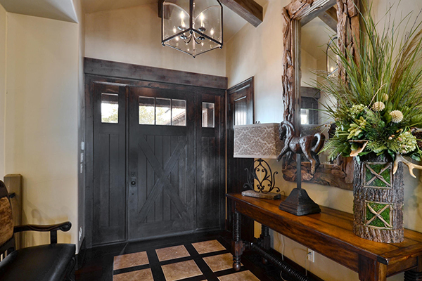 A beautiful lantern is a great choice for a foyer light. Home built by VII Custom Homes