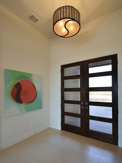 A unique semi-flush light fixture worked best for this foyer. Home built by VII Custom Homes
