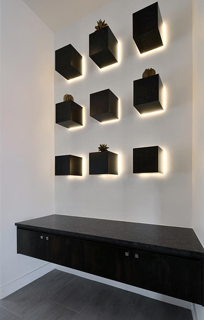 LED tape light accents cubes to create wall art.