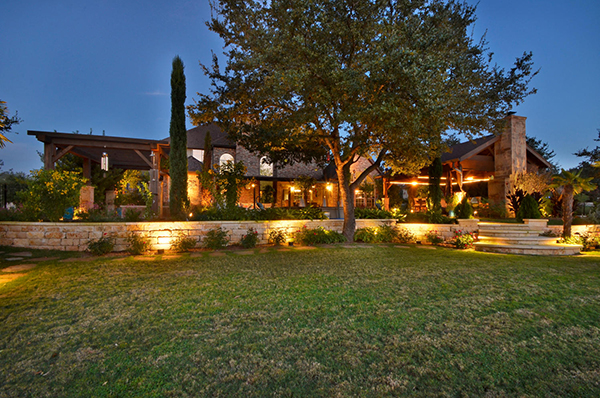 Landscape lighting adds a special ambiance to a back yard at night.