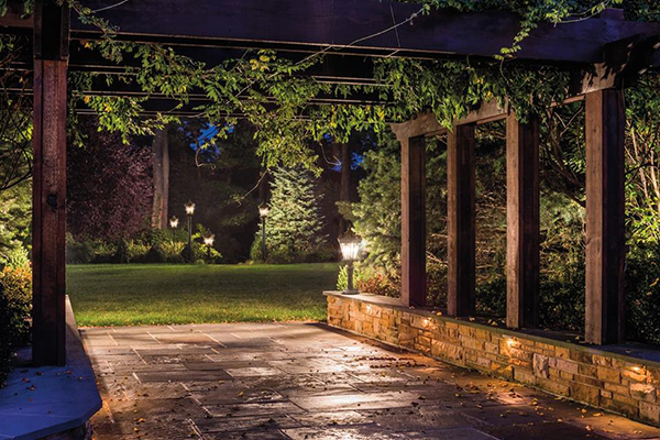 Landscape lighting can create a magical feel in your outdoor areas at night. Photo from Kichler Lighting