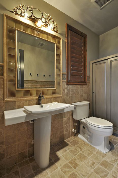 Varaluz Fascination is a great choice in this pool bath in a home built by Summit Builders with interior design by Interior Selections Austin.
